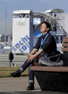 A woman takes in the sunlight at Sochi, where temperatures hit the 60s.